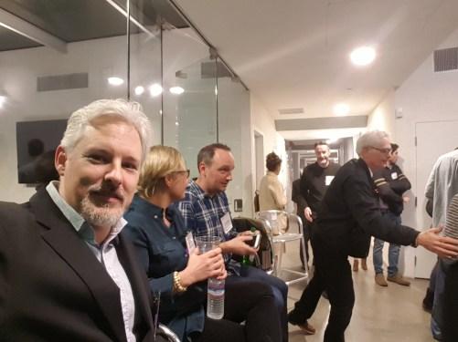 Chris Aldrich (near left) captures a quick selfie before the event.