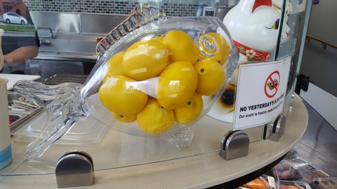 A glass fish full of lemons