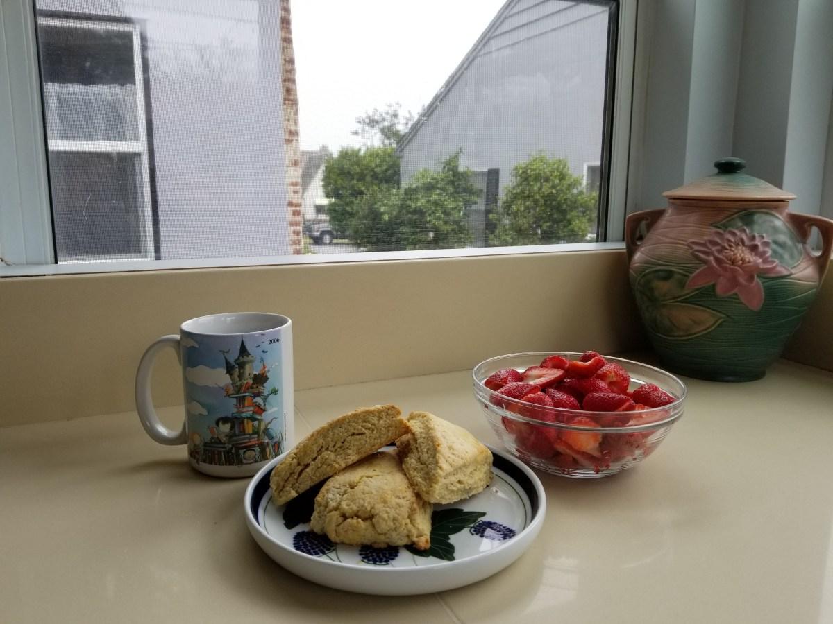Fresh scones, strawberries, and coffee
