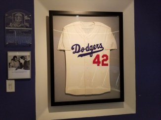 a framed Dodger's Jersey with a red #42 on the front