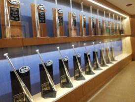 Two rows of batting awards down the side of a wall.