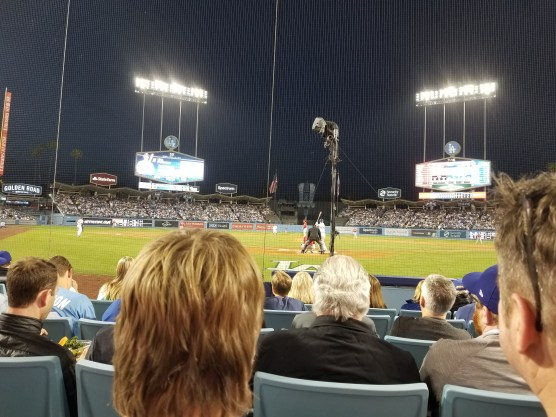 view of the field level at Dodger Stadium from six rows back immediately behind home plate