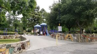 View of the park and playground equipment shut down for the pandemic