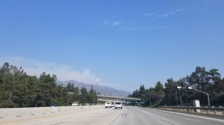 View of the smoke coming out of the mountains from the Bobcat Fire as seen from the 210 South into Pasadena