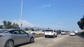 View of smoke emanating from the mountain near Mt. Wilson viewed from the 210 Freeway West in Old Town Pasadena