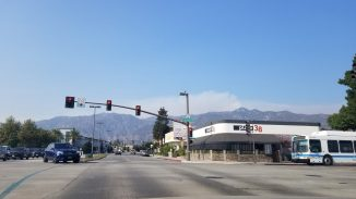 Smoke emanating from the Mt. Wilson/Telecom ridge viewed from the corner of Colorado Blvd. with Plate 38 in the foreground