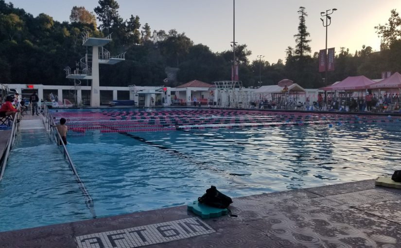 poolside at Rose Bowl aquatic center with diving tower in background