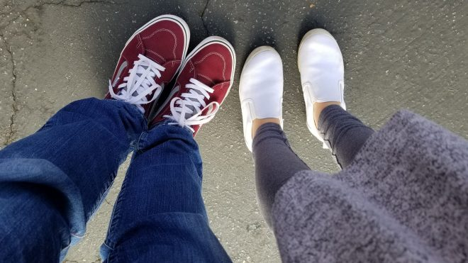 view down at legs from the waist of my burgundy vans and Evie's white keds