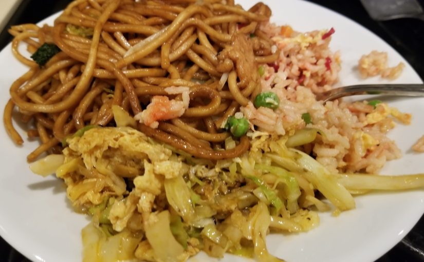 close up of noodles and rice on dish