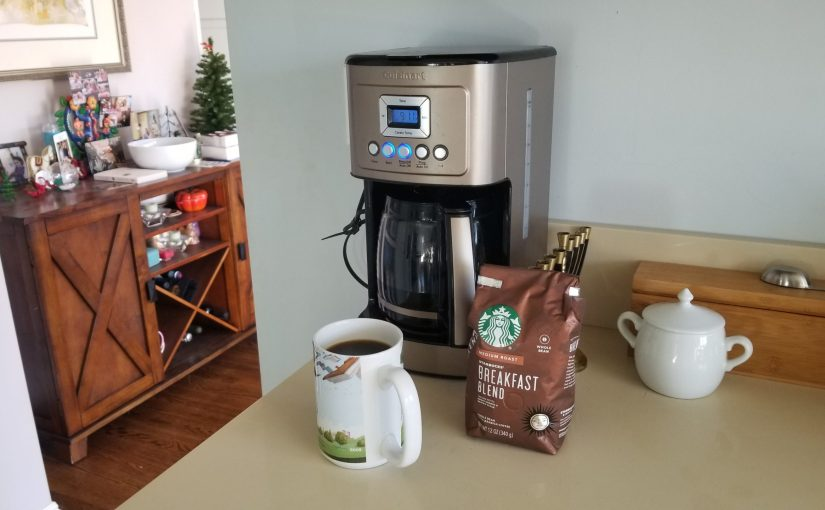 kitchen counter with coffee maker, coffee mug, and bag of coffee