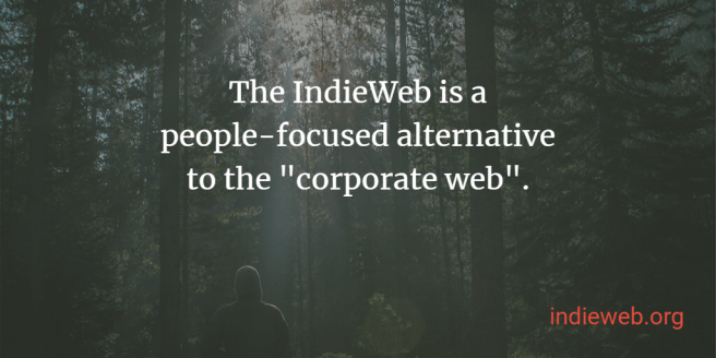 "sun shining down on a person in front of a vibrant forest superimposed with the text ""The IndieWeb is a people-focused alternative to the 'corporate web'. indieweb.org"""