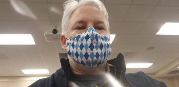 Close up selfie of Chris Aldrich wearing a blue facemask just after his second COVID-19 vaccine dose