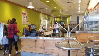 inside the front of Jamba Juice looking to the back. Tables are stacked up to prevent people from staying during the time of COVID-19