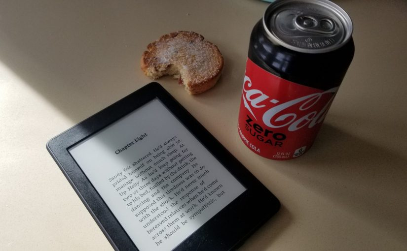 kitchen counter with Welsh cake, Coke Zero can and a Kindle Paperwhite