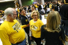 Sen. Claire McCaskill stands with her family Saturday at the MU alumni tailgate in the Georgia World Congress Center in Atlanta. McCaskill flew to Atlanta from Columbia to attend the Southeastern Conference championship game. TIM TAI/THE MANEATER