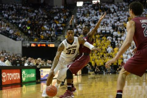Senior guard Earnest Ross (#33) drives past the South Carolina defense. Missouri led South Carolina 38-22 at the end of the first half. MICHAEL CALI /The Maneater