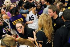 Hickman High students and players celebrate the women's basketball team's victory over the Rock Bridge Bruins, 45-35, on Wednesday. Shelby Baseler/Missourian