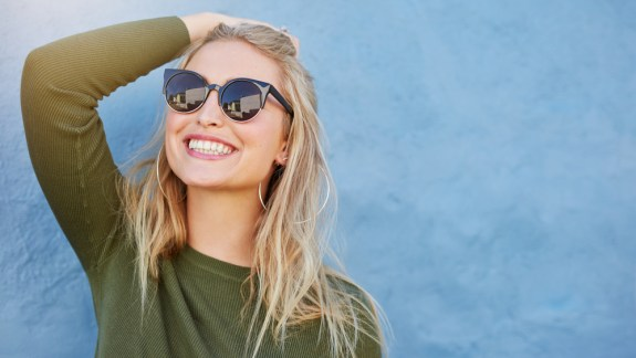 Happy woman wearing sunglasses