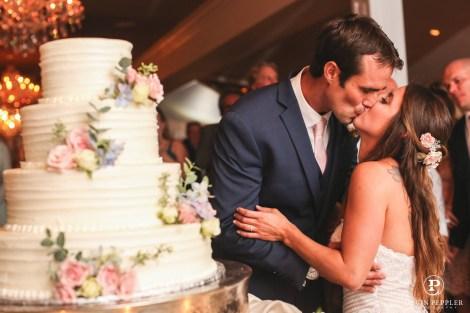 NJ beach wedding cake cutting
