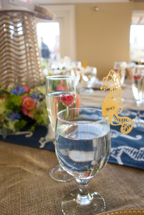 seahorse place card on water glass