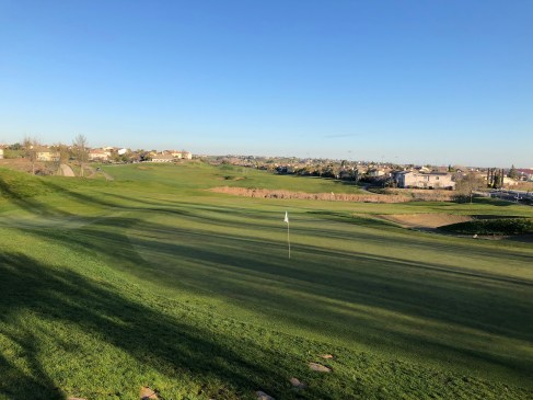 Above/behind 9th green.