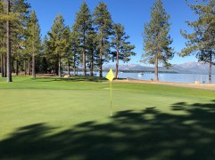 Side view of 9th green with lake in background.