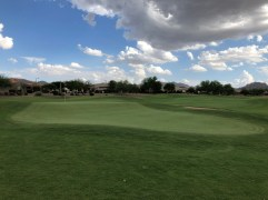 Back view of tough 14th green with a huge shelf in the middle.