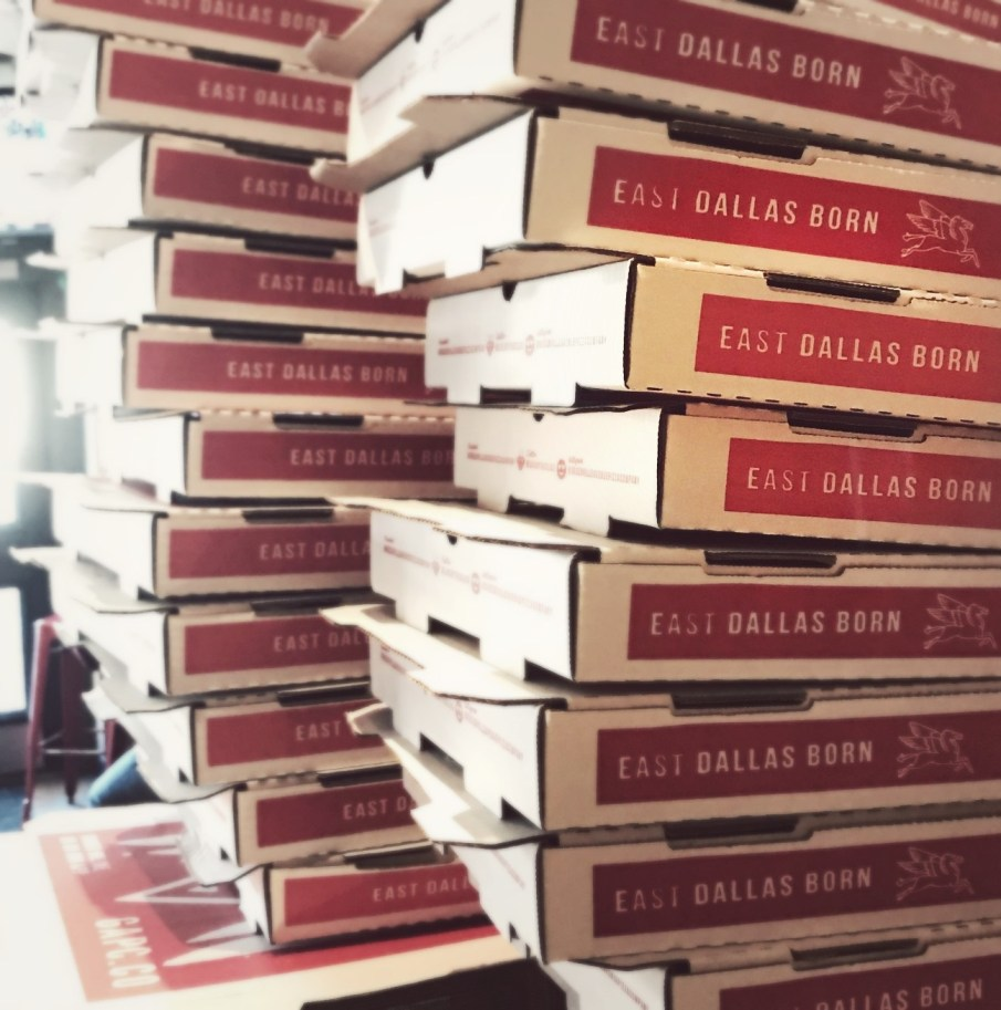 piled pizza boxes at greenville avenue pizza company