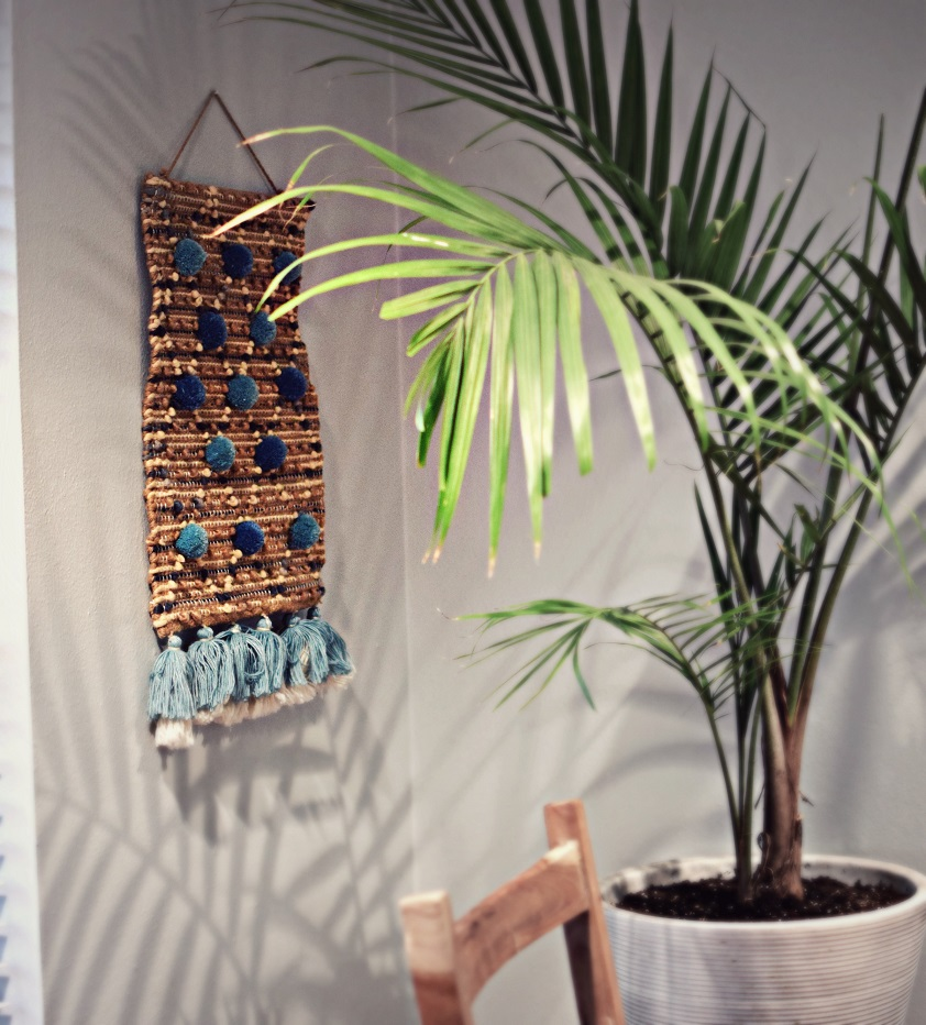 hanging bohemian wall décor with accent palm tree