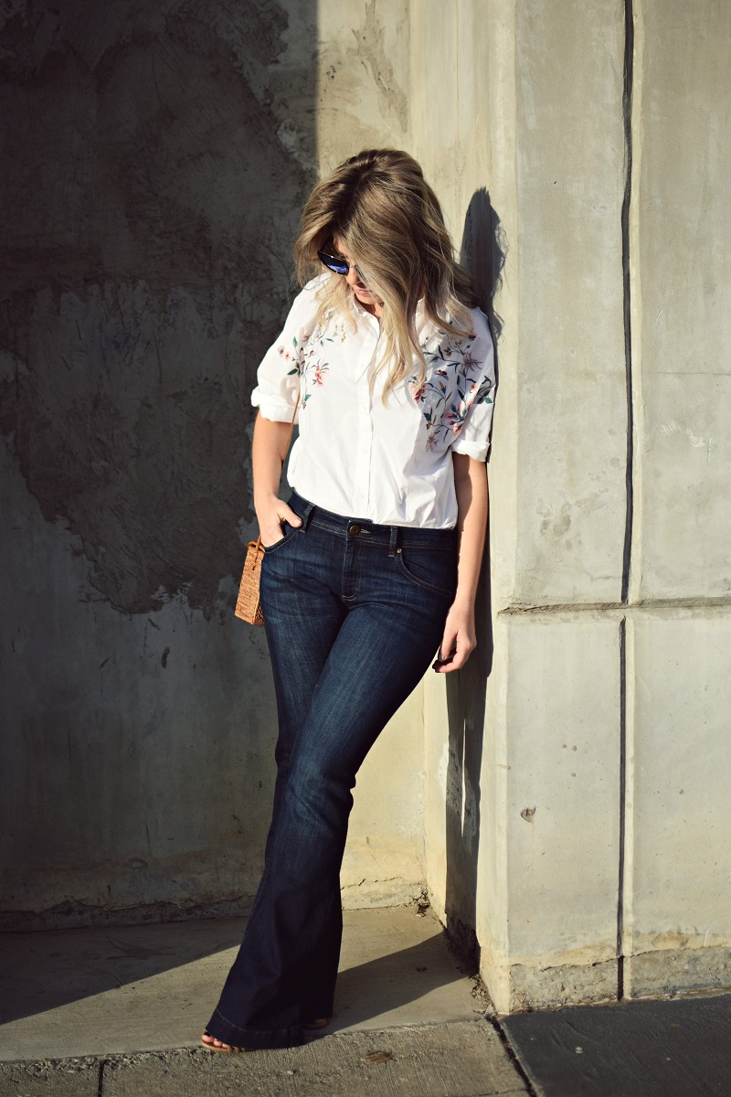 buffalo exchange flare jeans and white embroidered top
