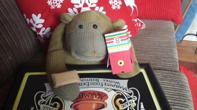 Daft Monkey's got the box stuck on his hand.