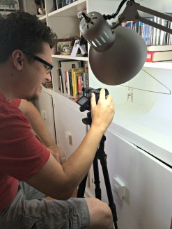 Behind the Scenes Photo Shoot. Rhys, my husband and supporter, taking intricate close up photos of some mighty dainty earrings.