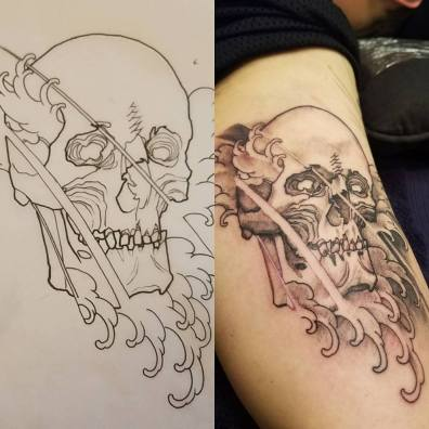 black and grey skull and waves