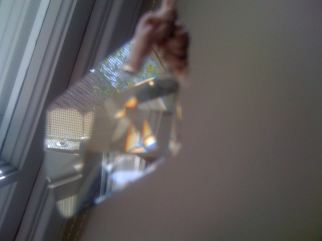 Prismatic light reflecting through crystal bead