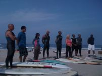 Nick Gabaldon day surfers for the paddle out, including Rusty White with the Black Surfers Collective
