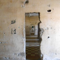 They cut holes right through the walls so the guards could see and walk from room to room easily