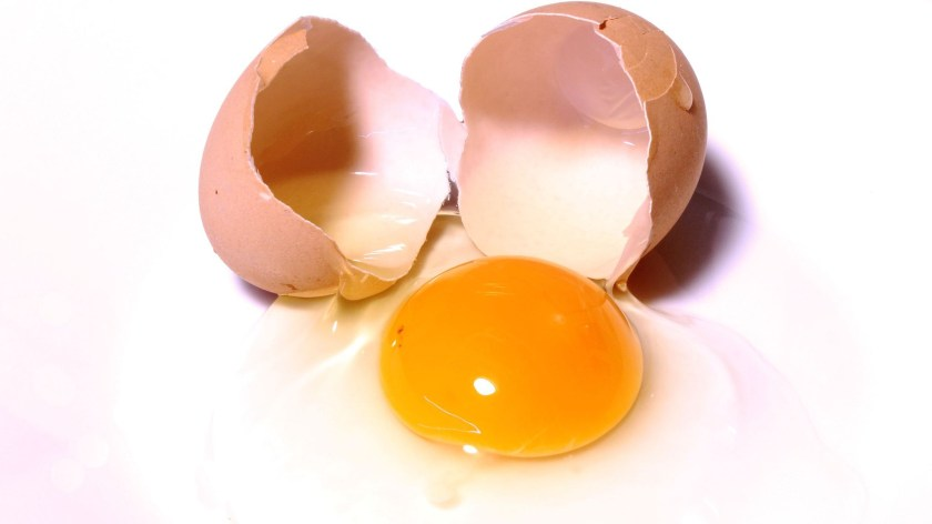 To keep bits of shell from getting into the part you eat, open an egg by smacking the side definitively - but not aggressively - on a flat, hard surface, stopping your hand when you hear a crack.