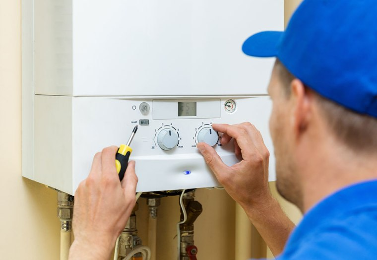 picture of an enginneer servicing a boiler