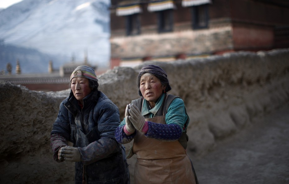 Ethnic Tibetan women pray around the Labrang Monastery ahead of the Tibetan New Year which starts on Wednesday in Xiahe county