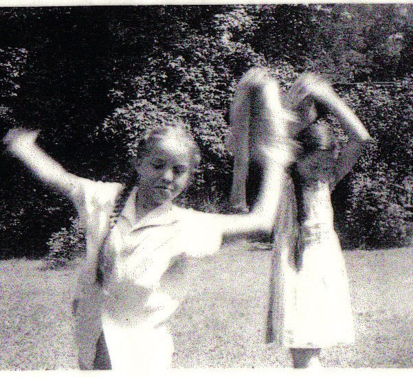 The author, doing cartwheels in her yard as a child.