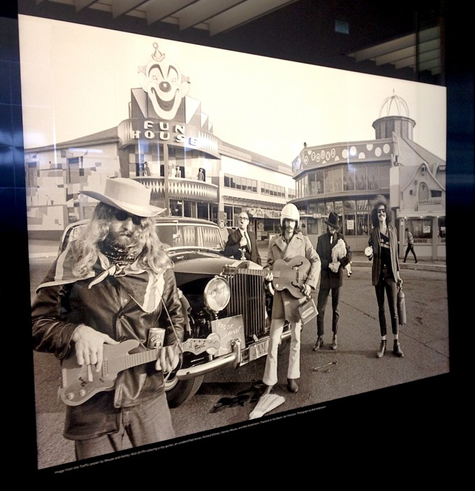 This Bob Seidmann photo was used on a Kelley/Mouse poster for show by Traffic. The motley crew hamming it up at Playland at the Beach includes (from left to right) Rick Griffin playing a toy guitar, an unidentified driver, Richard Ellman, Stanley Mouse, and Bob Seidemann.