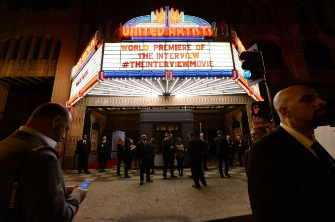 """Security guards stand at the entrance of United Artists theater during the premiere of the film """"The Interview"""" in Los Angeles, California December 11, 2014.  REUTERS/Kevork Djansezian"""