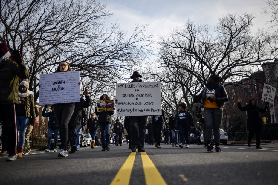 Demonstrators march along East Capitol Street to join a protest against police violence organized by the National Action Network in Washington December 13, 2014. REUTERS/James Lawler Duggan