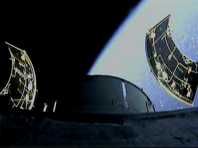 An onboard camera captures separation of the three 13 by 14-foot Orion service module fairings following lift off the Delta IV Heavy rocket from Space Launch Complex 37 at Cape Canaveral Air Force Station in Florida. The flight test also will validate systems such as Orion's parachutes, avionics and attitude control, and demonstrate major separation events such as the launch abort system jettison and the service module fairing separation. Photo: NASA