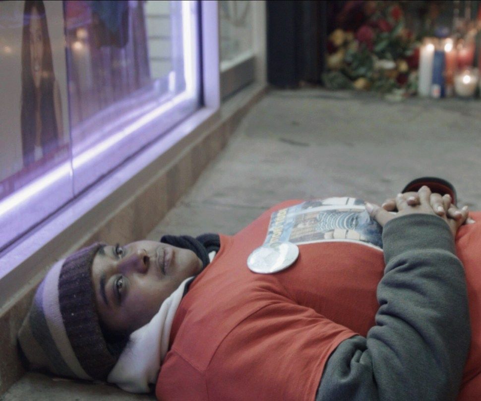 """Erica Garner, 24, daughter of Eric Garner, staging a """"die-in"""" at the spot on the pavement where her father died at the hands of NYPD officers. The officers were not charged with any crime. Photo: Aaron-Stewart Ahn."""