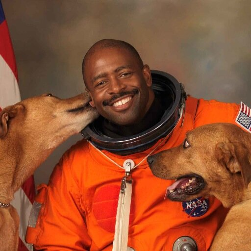 Leland Melvin, former astronaut and Associate Administrator for Education at NASA, with 2 of his many adoring fans.
