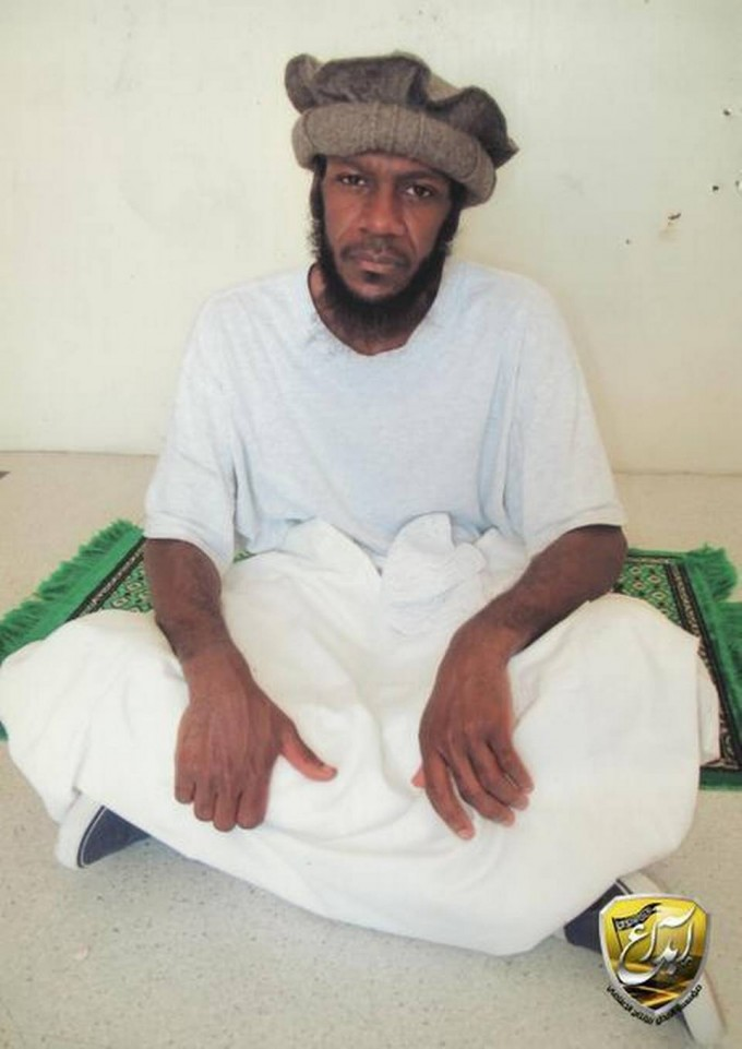 """""""Guantánamo prison photo of Saudi Mustafa al Hawsawi, accused of helping the 9/11 hijackers with funds and travel, turned up on Middle Eastern websites. He is seen sitting on a prayer rug and posing for the International Committee of the Red Cross in prison-approved images taken for family members."""""""