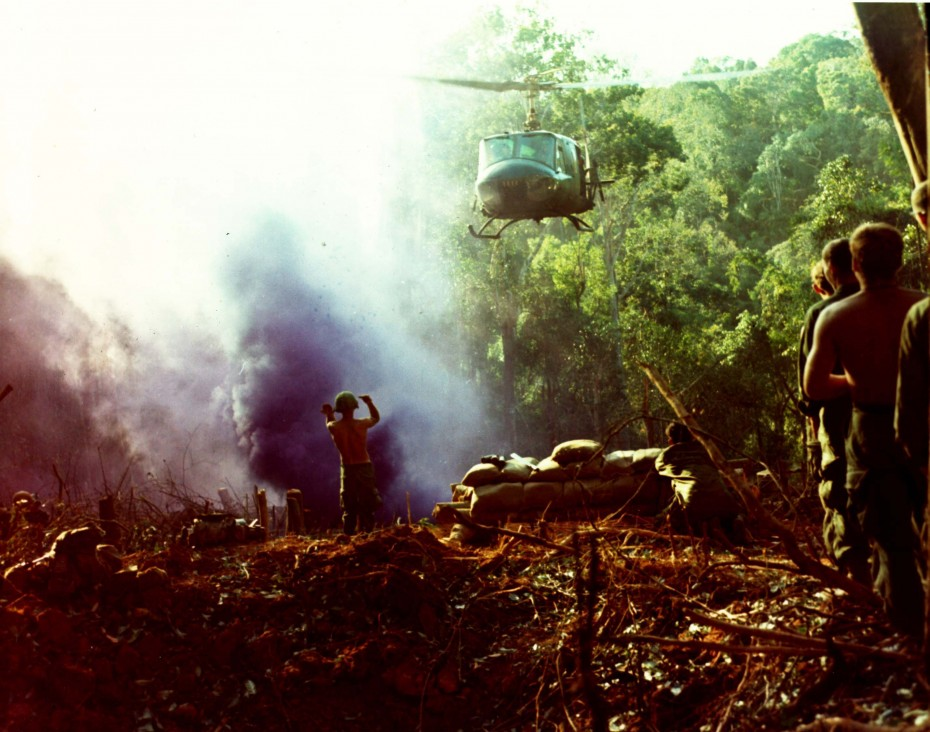 U.S. soldiers of the 4th Infantry Division assemble on top of Hill 742, located five miles northeast of Dak To, prior to moving out, November 1967. A purple smoke bomb is ignited in the background to guide in a helicopter. REUTERS/Courtesy U.S. Army