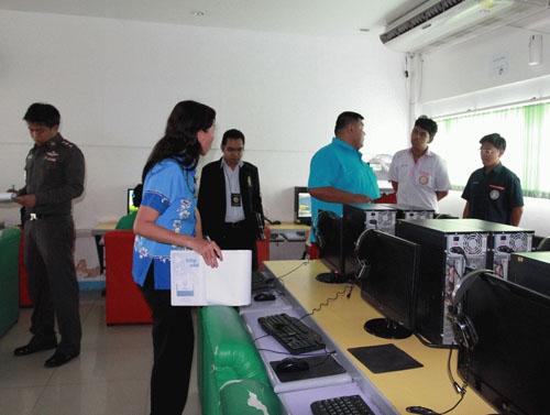 Thai censorship officials visit an internet cafe in Bangkok