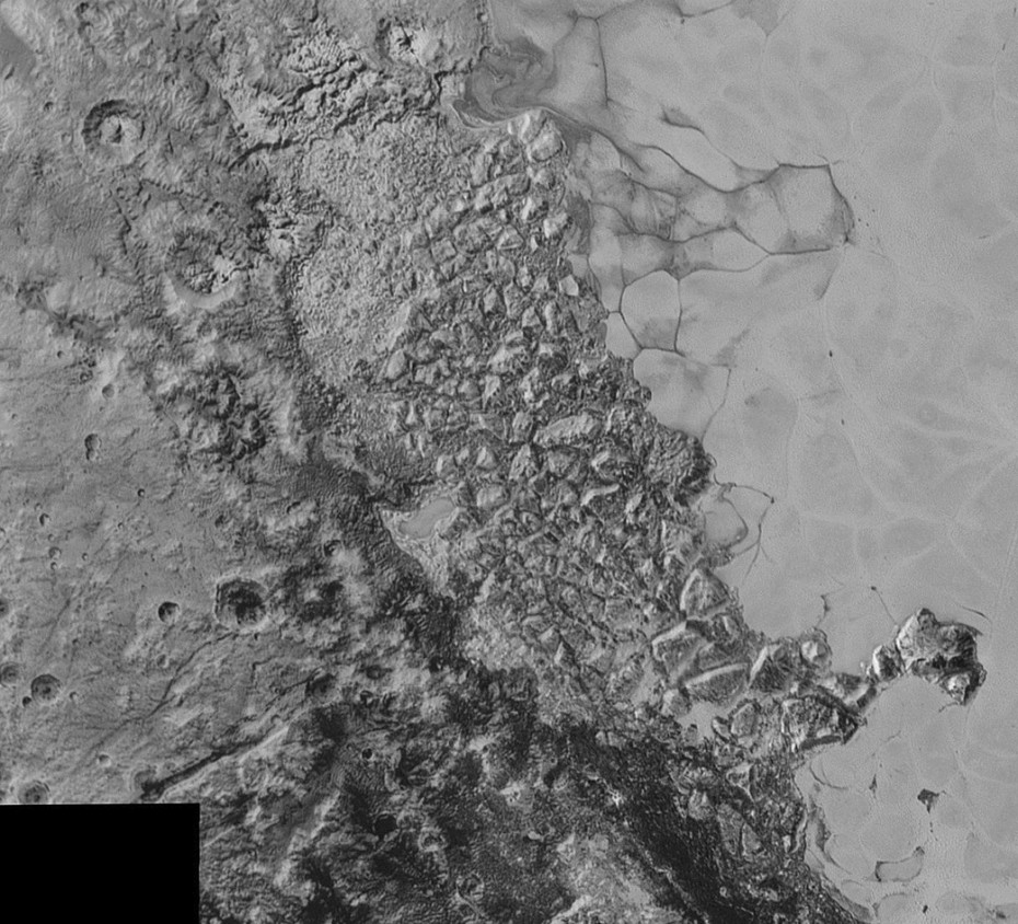 In the center of this 300-mile (470-kilometer) wide image of Pluto from NASA's New Horizons spacecraft is a large region of jumbled, broken terrain on the northwestern edge of the vast, icy plain informally called Sputnik Planum, to the right. The smallest visible features are 0.5 miles (0.8 kilometers) in size. This image was taken as New Horizons flew past Pluto on July 14, 2015, from a distance of 50,000 miles (80,000 kilometers).